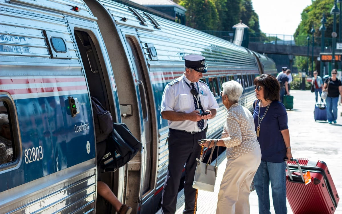 An Amtrak conductor checks tickets before continuing north. | Photo by Andrew Frey