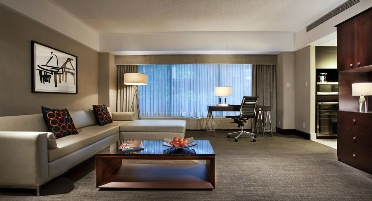 A comfortable, modern living room setting in one of the hotel's suites. | Photo from Hotel Bonaventure Montréal