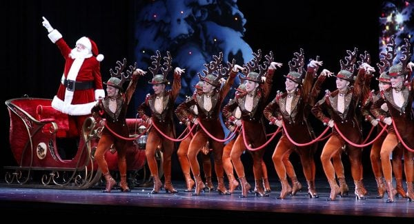 Santa Claus and The Rockettes line the stage at Radio City Music Hall. | Photo from Radio City Christmas Spectacular