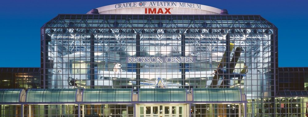 The gorgeous, glass exterior Reckson Center in Garden City, NY at night.   Photo from Cradle of Aviation Museum