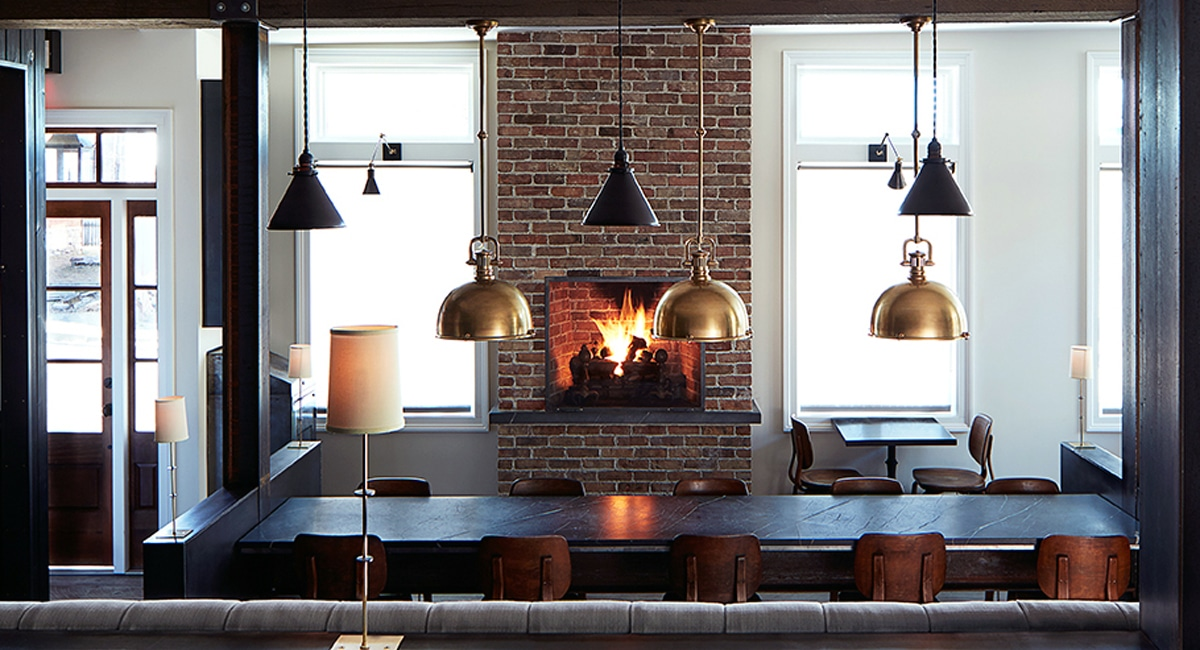 A view of the cozy restaurant from the barroom and lounge. Curl up by the fireplace and enjoy a wonderful meal and cocktail. | Photo from Wm Farmer and Sons