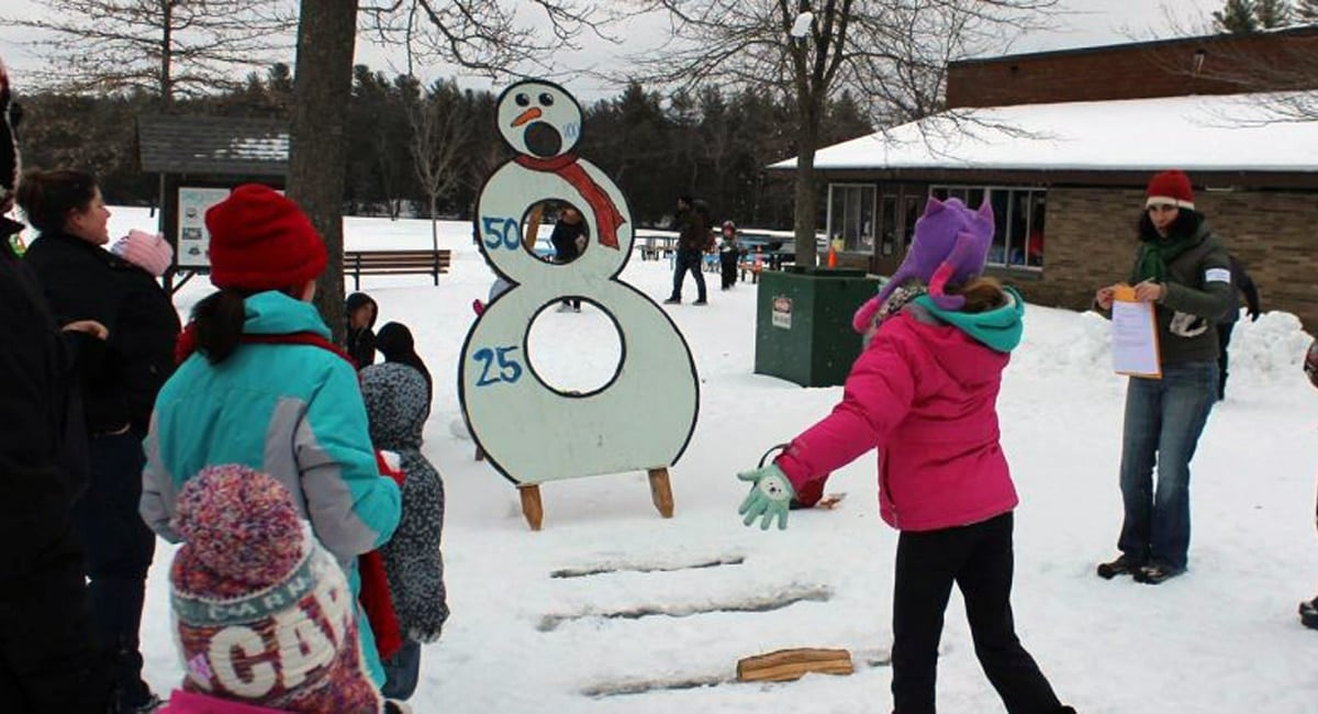 Kids enjoying a game of snowman beanbag toss | Photo from Winter Fest at Grafton State Park