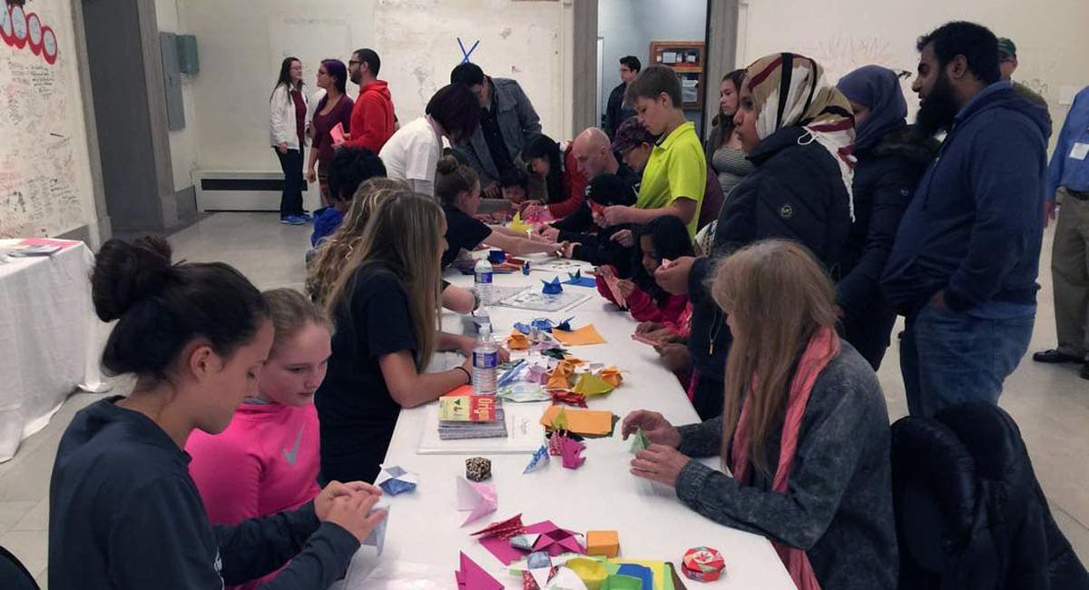 Festival Goers Making Origami at the Buffalo Cherry Blossom Festival | Photo from Buffalo Cherry Blossom Festival