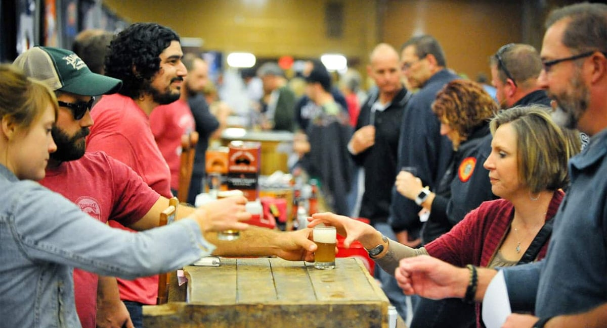 Visitors enjoying hundreds of local and imported craft beers at Saratoga Beer Week. | Photo from America-on-Tap