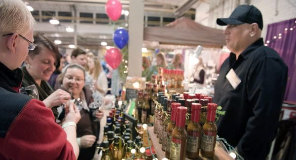 Festival-goers enjoying some free samples at the Wine & Chocolate Festival in Utica, NY. | Photo from Wine & Chocolate Festival