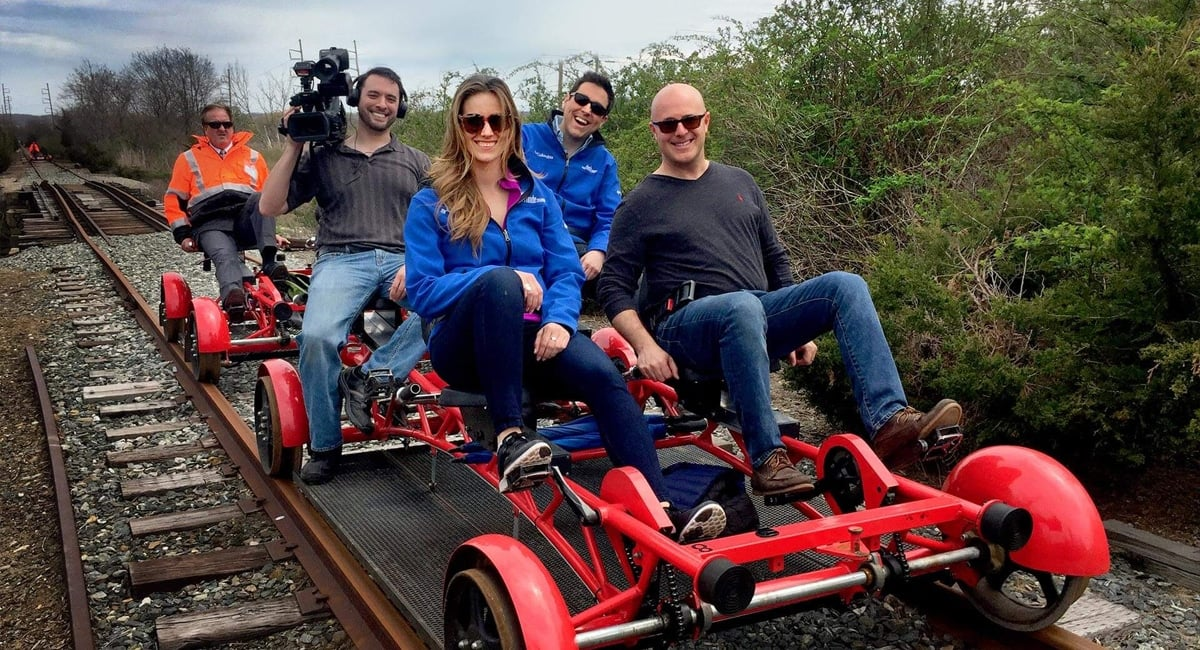 Guests pedaling down the tracks | Photo from Rail Explorers
