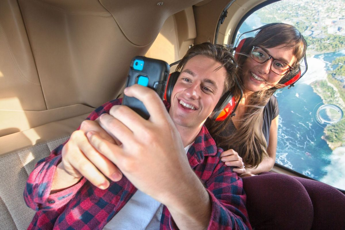 Passengers snap a pic while taking a Rainbow Air Helicopter tour of Niagara Falls