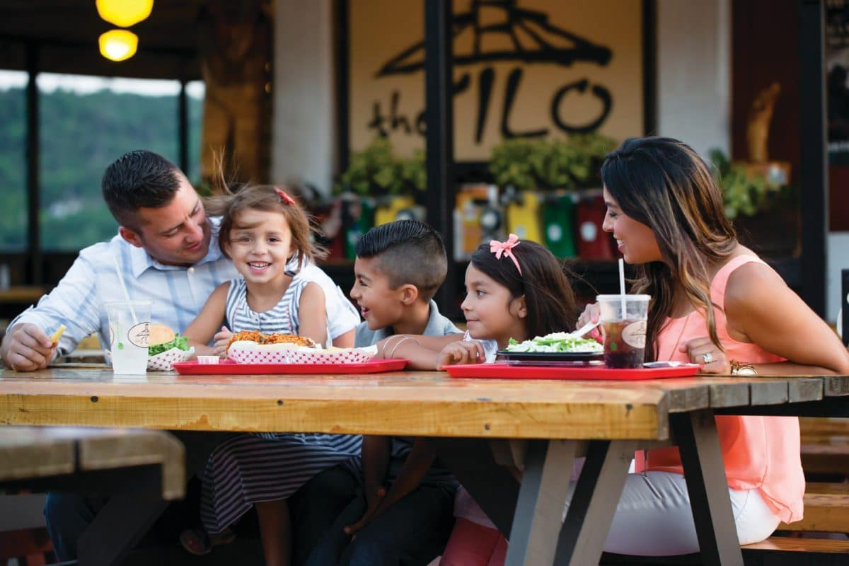 A family enjoying a classic American meal at the Silo.