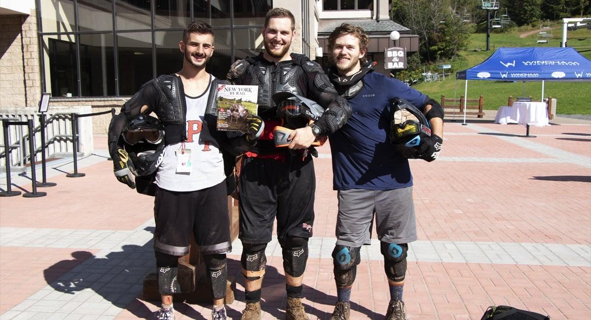 Trio of Mountain Bikers holding NYBR Magazine at Windham | Allyson Macci