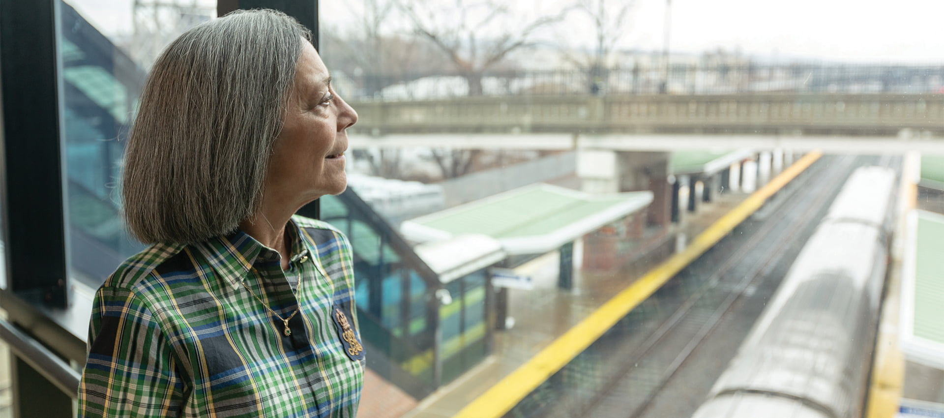 Sandy Nardoci looks out at the Amtrak yard at the Albany-Rensselaer station. Hope in Healing | Voices of Hope | Photo Courtesy of Filmworks 109