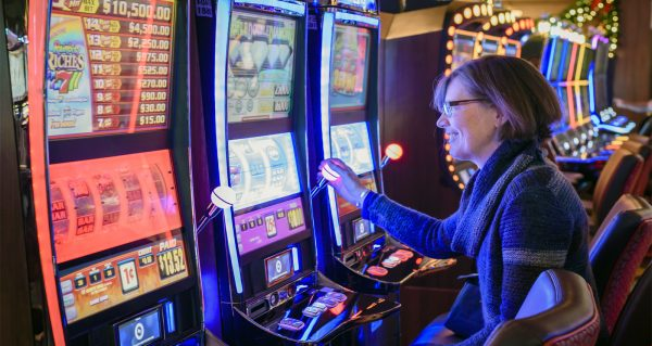 A woman playing slots at Rivers Casino & Resort. | Photo Courtesy of Andrew Shinn